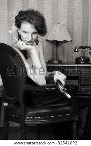 woman at retro stile with cigarette and pistol