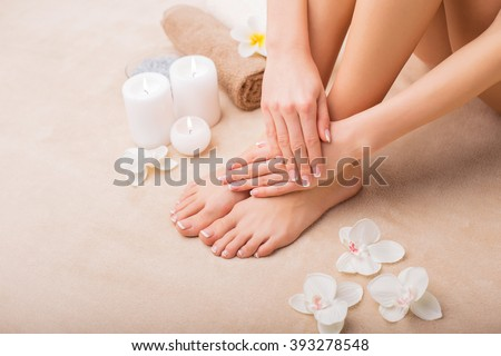 Woman at spa with done manicure and pedicure  - stock photo