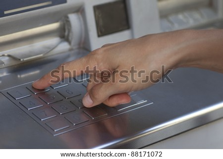 Woman at the ATM - stock photo
