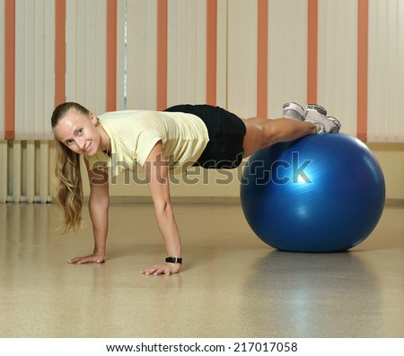 Woman at the gym with a pilates ball