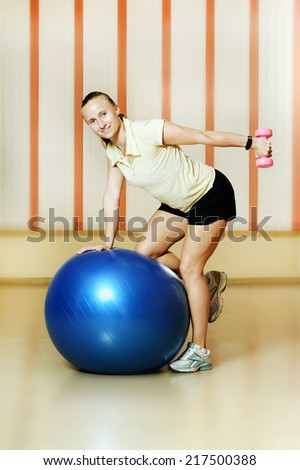Woman at the gym with a pilates ball - stock photo