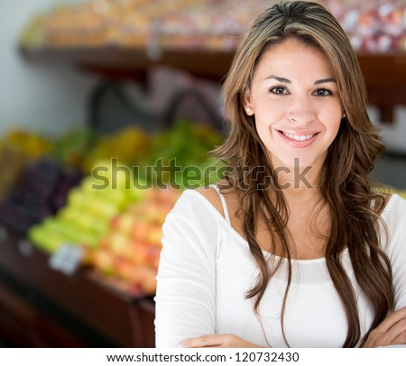 Woman at the local market looking happy - stock photo