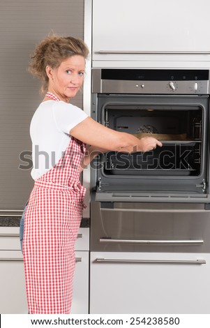 woman at the oven