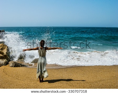 Woman at the sea - stock photo