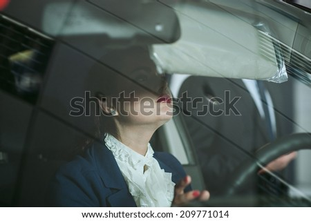 woman at the steering wheel of the car - stock photo
