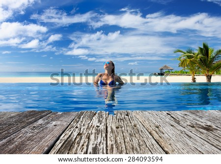 Woman at the swimming pool  - stock photo
