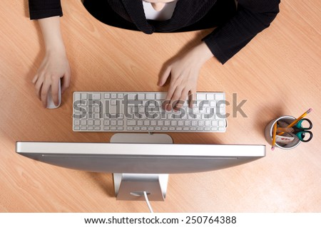 Woman at the work place at office - stock photo