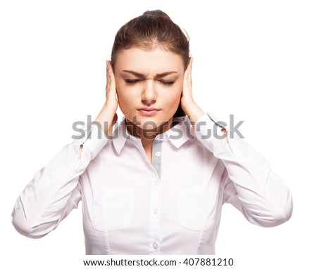 Woman at white background. Young female covering her ears. Ignorance - stock photo