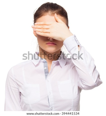 Woman at white background. Young female covering her face with her hands - stock photo
