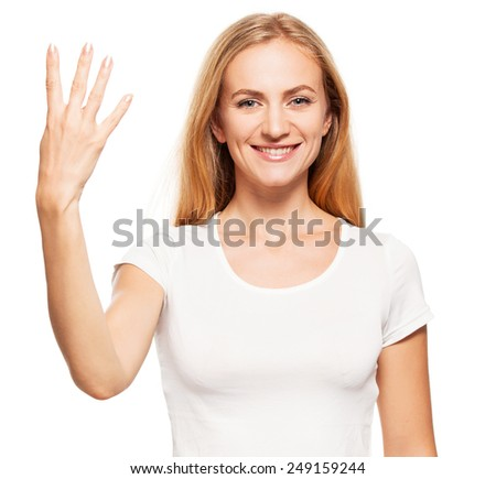 Woman at white background. Young female shows gesture four - stock photo