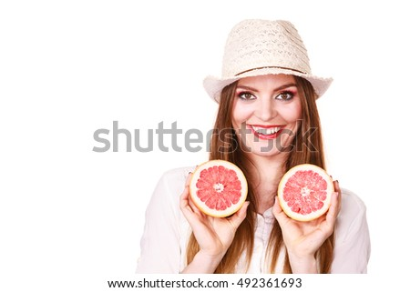 Woman attractive long hair girl colorful eyes makeup holding two halfs of grapefruit citrus fruit in hands. Healthy diet food. Summer holidays fun concept, on white