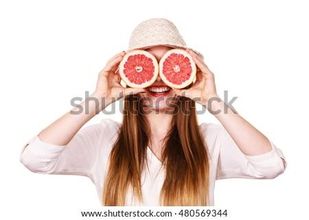 Woman attractive long hair girl holding grapefruit fruits slices for her eyes on white. Smiling female recommending healthy food. Summer holidays happiness concept