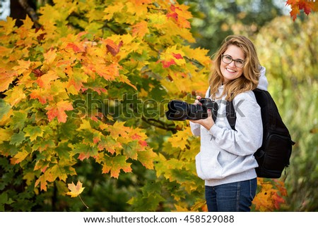 woman autumn, photographer - stock photo