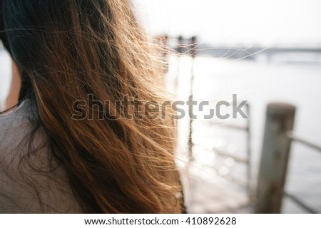 woman back alone sad girl - stock photo