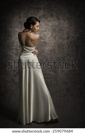 Woman Back Beauty Portrait, Elegant Lady Posing in Sexy Dress, Sensual Beautiful Girl in Long Fashion Gown - stock photo
