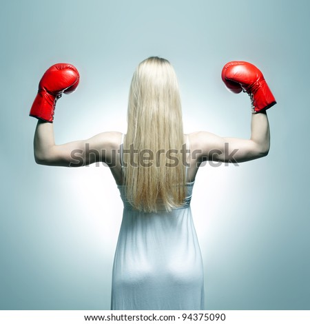 Woman back in white dress with red boxing gloves. Boxer bride