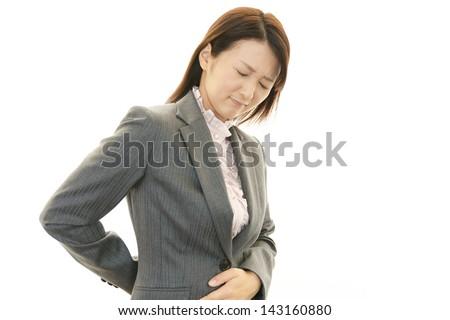 Woman back pain - stock photo