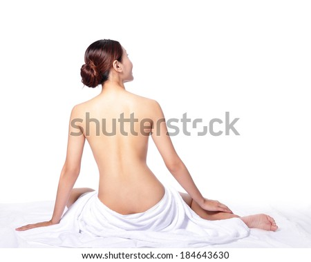 woman back view and wearing towel sitting on the floor, isolated on white, asian