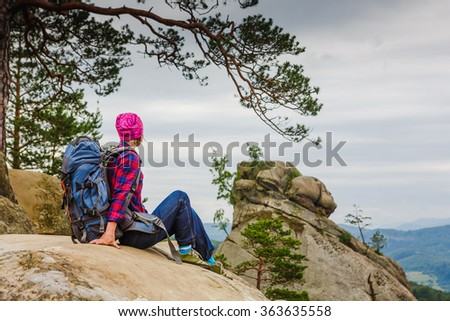 woman backpacker in the mountains enjoy the view - stock photo