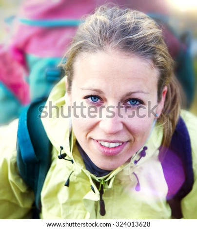 Woman Backpacker Outdoor Adventurist Hiking Concept - stock photo