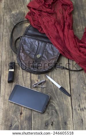 woman bag stuff, handbag on wooden background - stock photo
