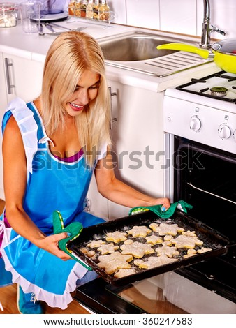 Woman bake cookies