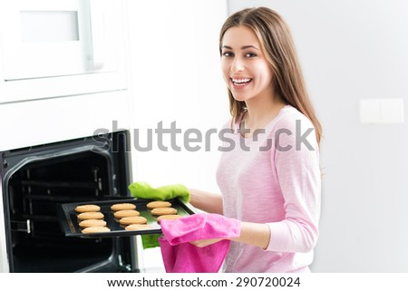 Woman baking cookies  - stock photo