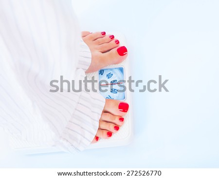 Woman barefoot standing on scales, 50 kilogram, body part, healthy lifestyle and nutrition, result of diet and fitness, weight loss concept - stock photo