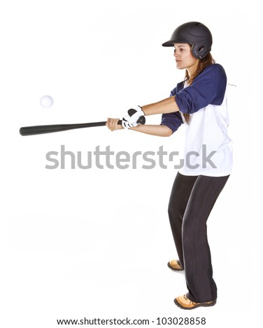 Woman baseball or Softball player hits a ball with a bat isolated on white. - stock photo