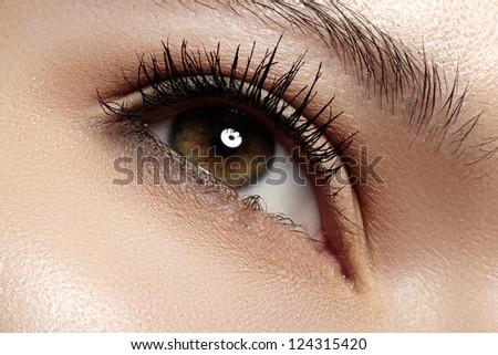 Woman beautiful eye with naturally long eyelashes. Macro shot. Wellness and spa, health and cosmetics. Natural make-up with black mascara on lashes. Long naturel eyelashes - stock photo