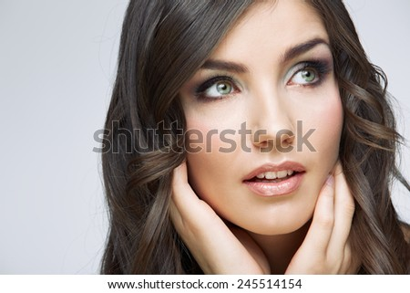 Woman beautiful face portrait. Skin care style face hand touching. Female model studio posing. - stock photo