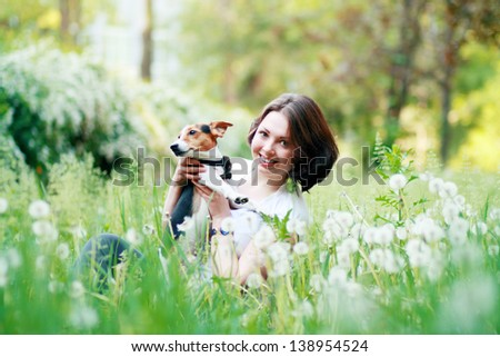 woman beautiful young happy with dark hair holding small dog Jack Russell Terrier