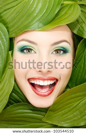 woman beauty face with green leaves fresh frame - stock photo