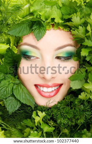 woman beauty face with greens vegetables frame isolated on white background - stock photo