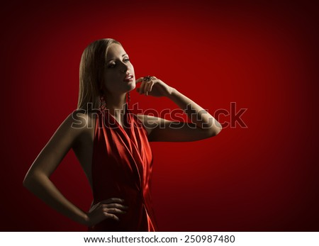 Woman Beauty Portrait, Beautiful Lady Posing in Elegant Red Dress, Fashion Model with Blond Hair, Girl Touching Face - stock photo