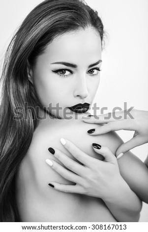 woman beauty portrait with black lips and black white nails, studio