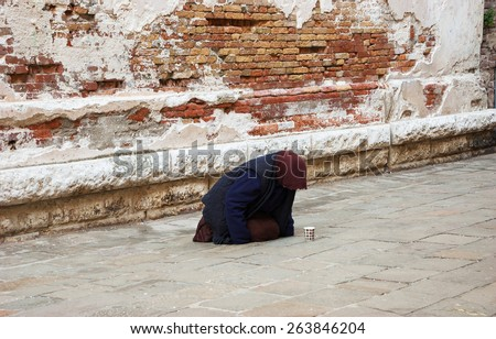 Woman begging in Venice (Italy).  - stock photo