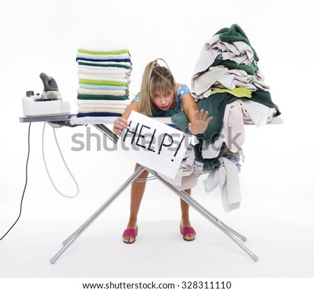 Woman behind a table covered with clothes to be ironed, displays a sign with help - stock photo