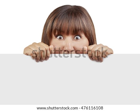 Woman behind blank banner looking surprised and scared isolated
