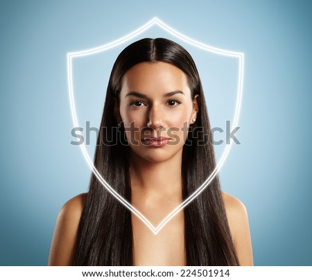 woman behind the shield. Concept of a skin protection - stock photo