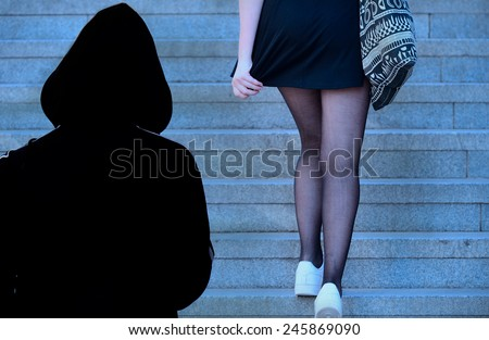 Woman being followed - stock photo