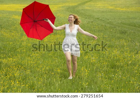 Woman being happy in a green field