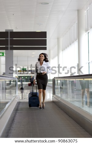 Woman being late at the airport - stock photo