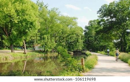 Woman Biking at Great Falls Park in Maryland ,USA - stock photo