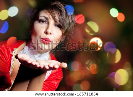 Woman blowing a kiss