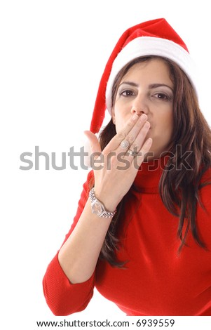 Woman blowing a kiss with santa hat - stock photo
