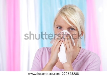 Woman blowing her nose with a handkerchief