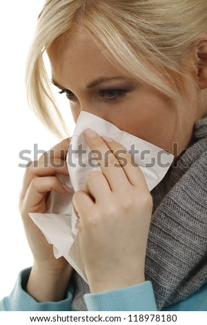 woman blows the nose