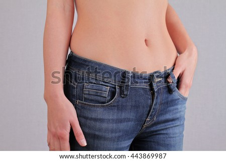 Woman body fat belly, muffins. Weight loss, dieting concept