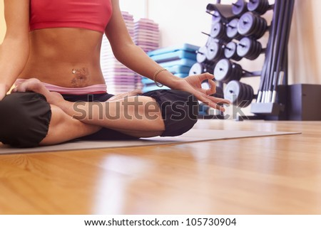 Woman body in yoga asane on the floor